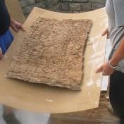 Transferring the mosaic fragment.