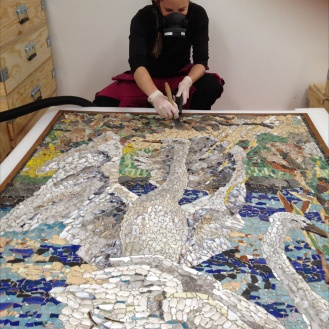 Cleaning the mosaics.