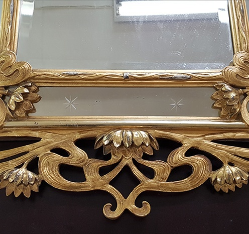 Bottom ornamental part of the frame after reconstruction and retouching.